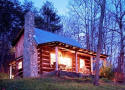 Log cabin rental with view of the French Broad River